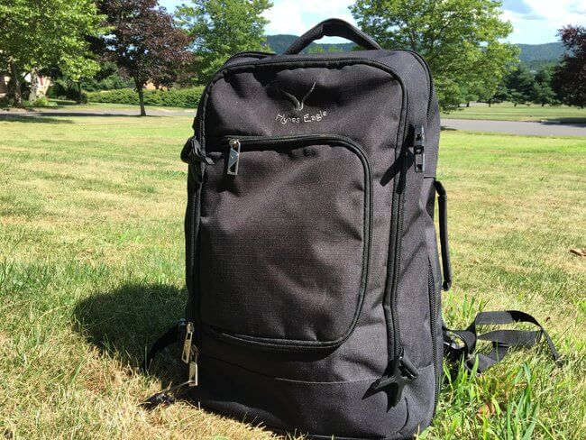 black backpack sitting on grass