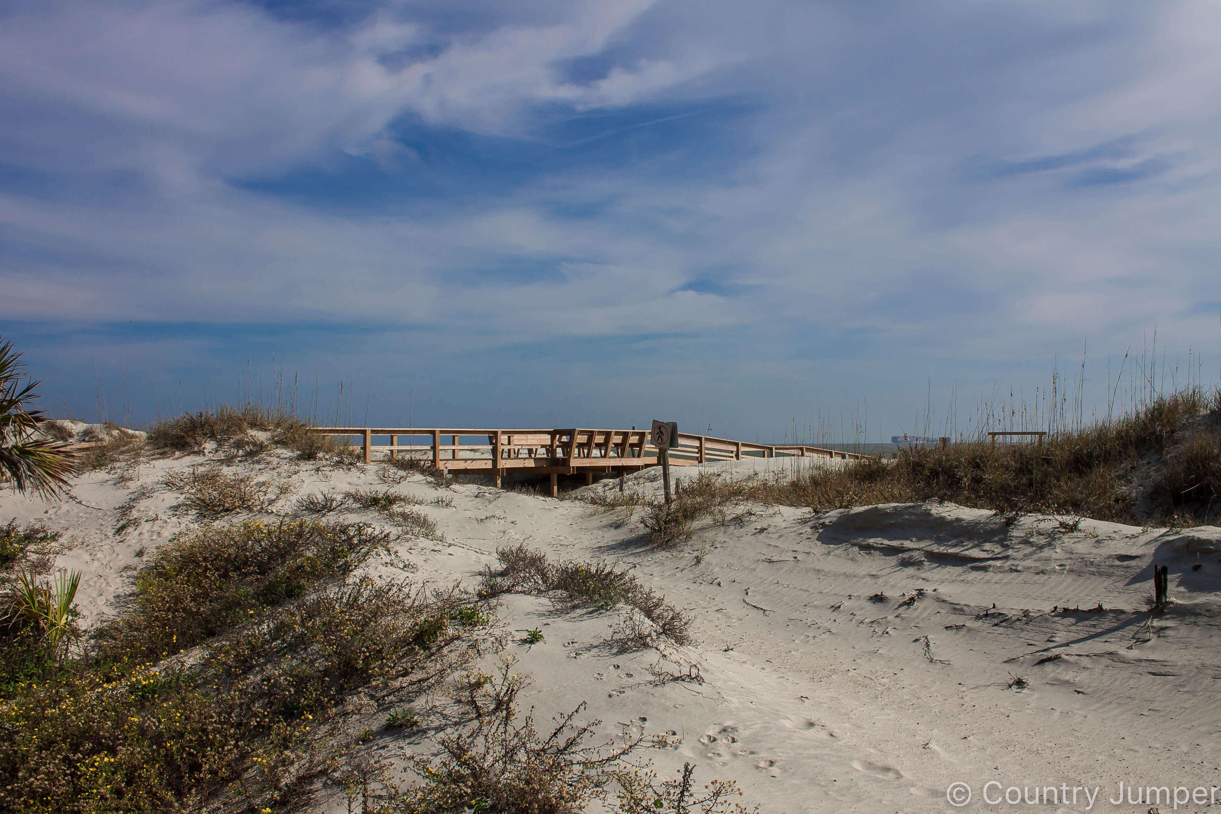 sandy dune underneath a blue sky