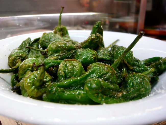 green pimiento peppers de patron blistered in white bowl