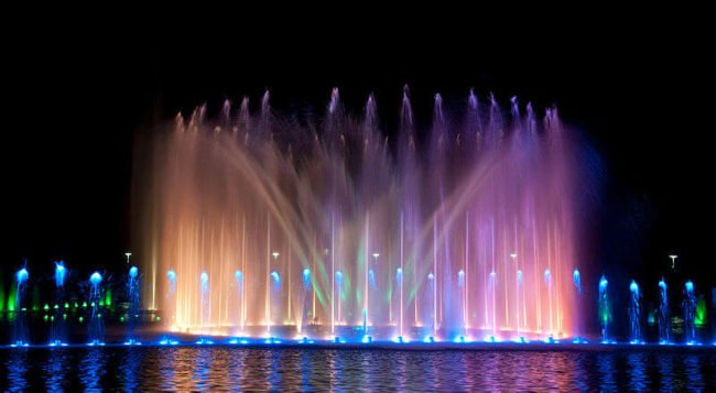 fountain lit up in colored lights