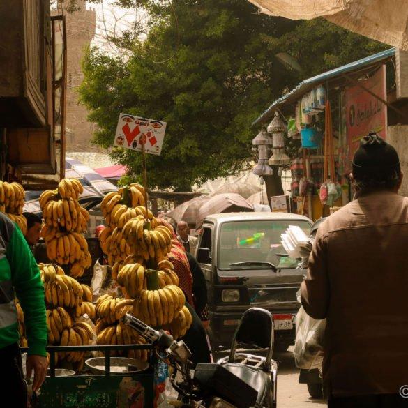 banana cart comes down street of people