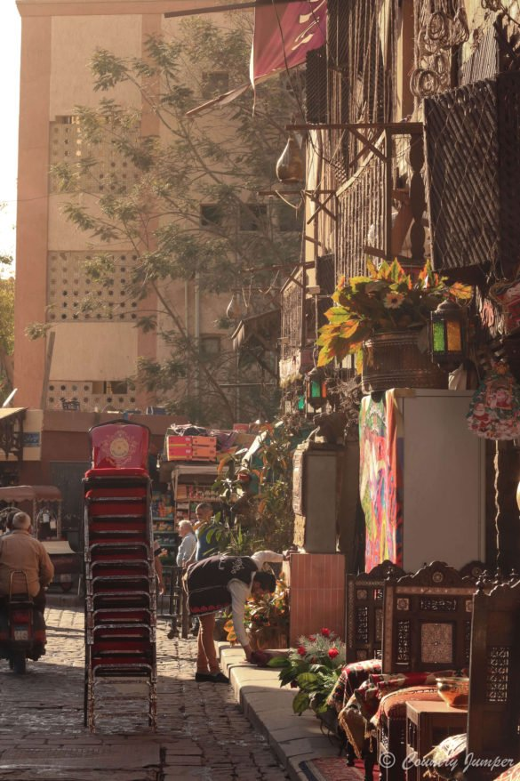 stack of red chairs outside of cafe in cairo