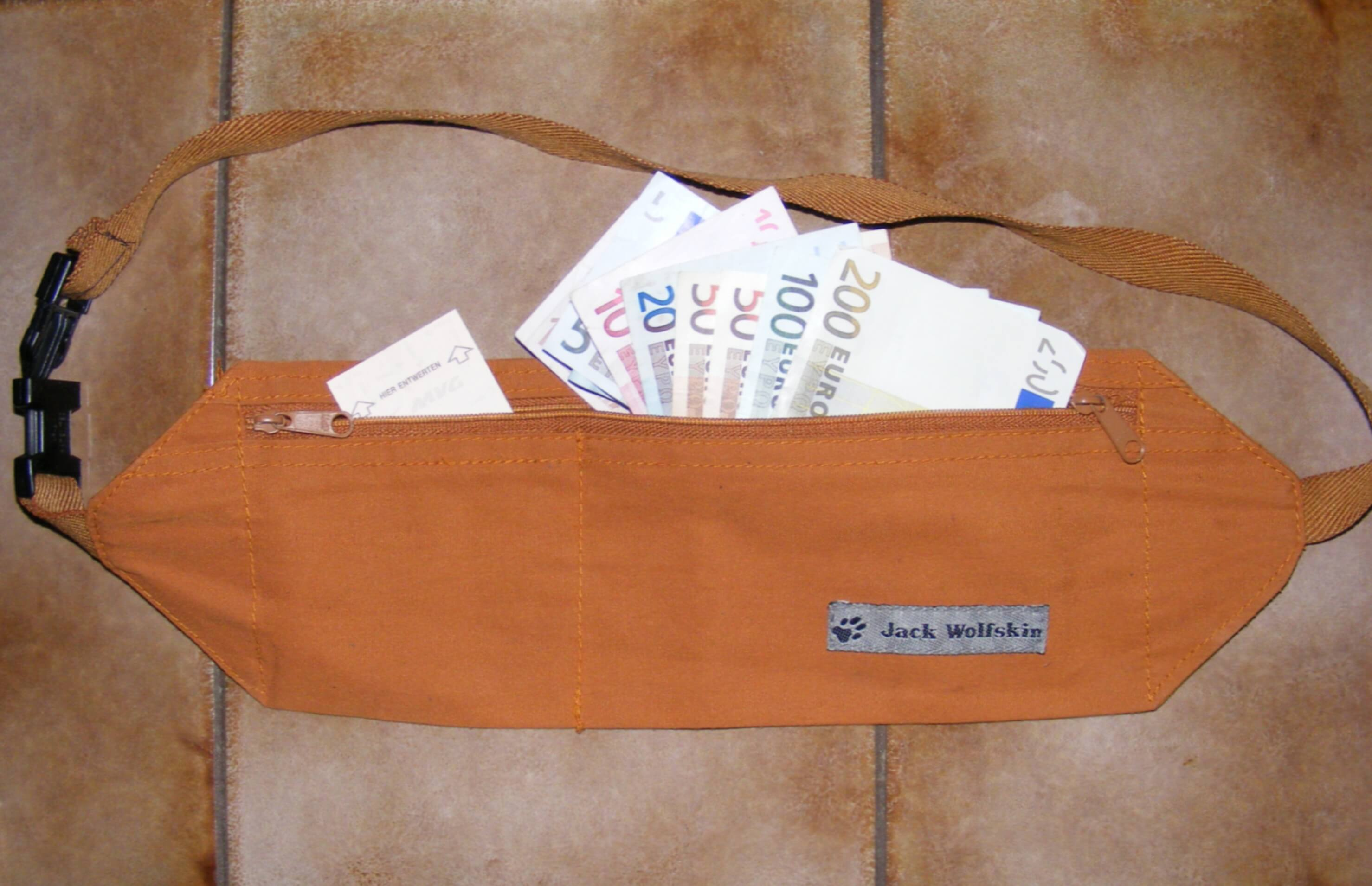 Euros sticking out of Jack Wolfskin money belt