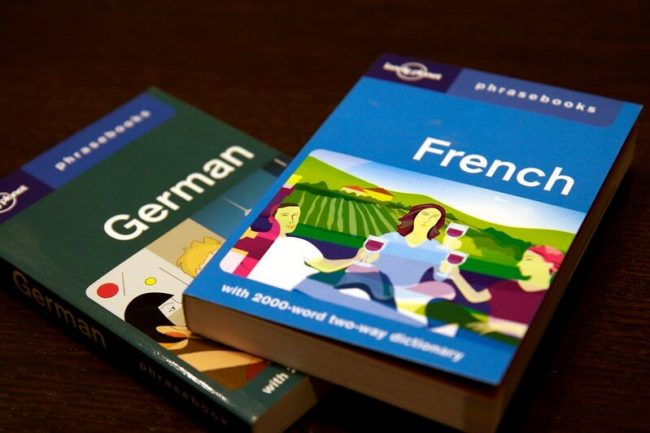 French and German phrase books laid out on table