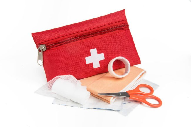 red first aid pouch with supplies