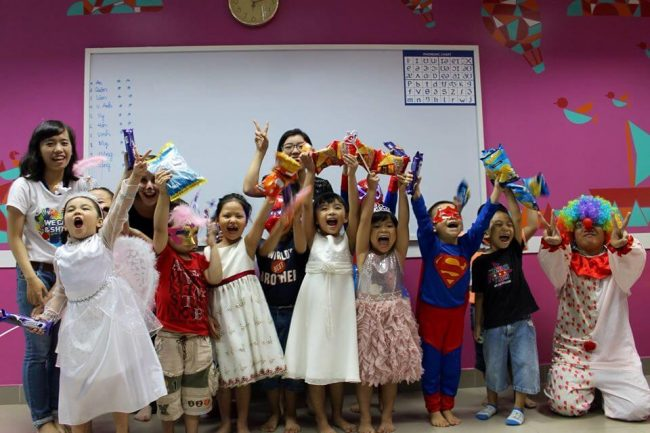 Vietnamese students in a classroom dressed up for halloween