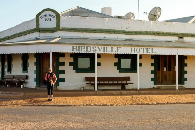 woman standing in front of birdsvsll hotel in Australia