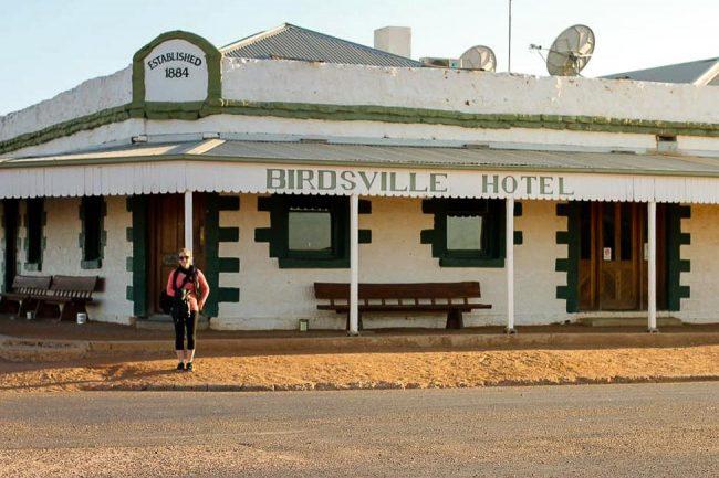 woman standing in front of birdsvsll hotel in Australia