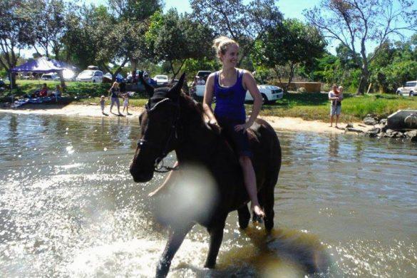 women riding horse on the beaches of Gold Coast australia