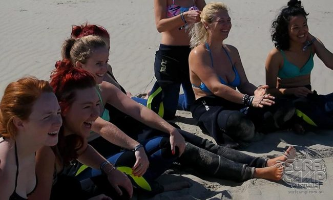 women at surf camp laughing