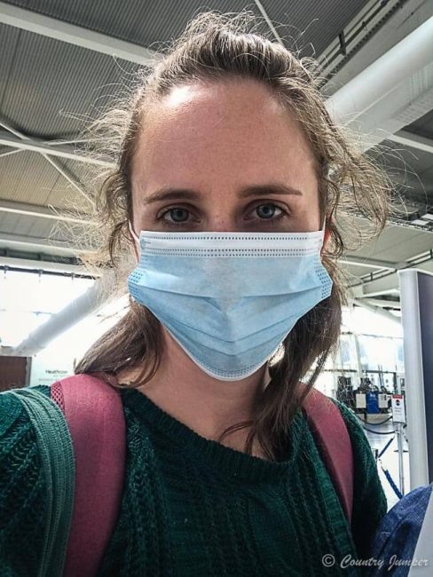 woman wearing mask in airport during COVID-19